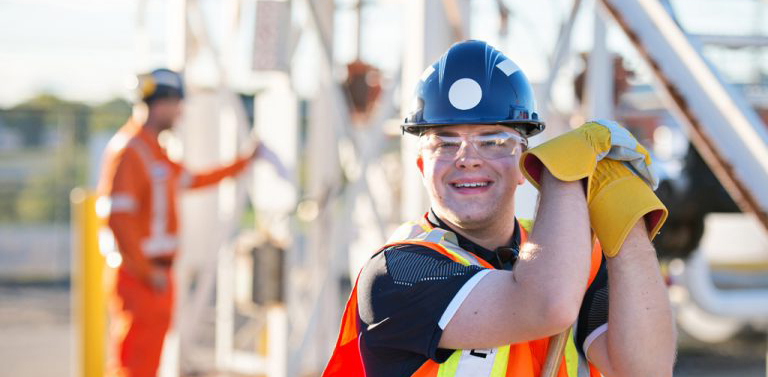 Man with an intellectual disability in construction uniform, happily working