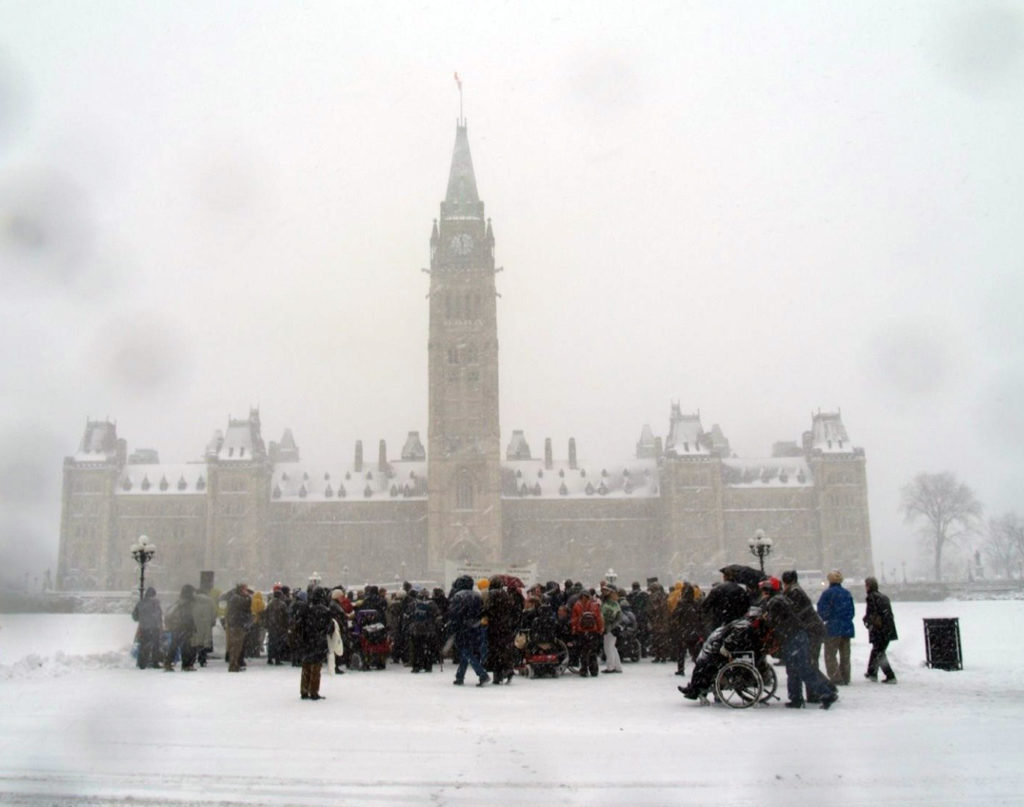 CACL and advocates outside Canadian Parliament in snow storm.