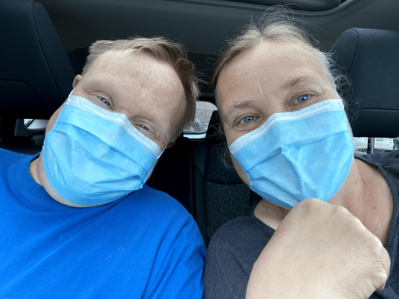Photo of Helen and her brother Paul together with blue face masks on